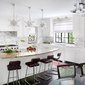 Apron Sink And Breakfast Bar Also Copper Cookware With Dark Flooring Plus Star Pendant Lightings And Kitchen Island Also Backsplashes With Range Hood And Roman Shades In Traditional Kitchen