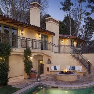 Arched Openings And Climbing Plants In Meditarranean Exterior With Curved Stairs Plus Iron Railings And Fire Pit Also Lanterns For Night Lighting With Wall Seating Plus Decorative Pillows For Couches Also Swimming Pool