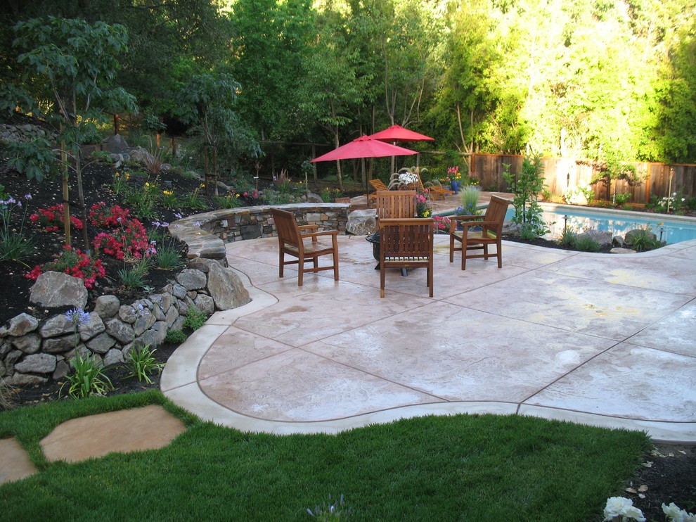 Top Materials for Patio Using Stamped Concrete Patio: Architect For Traditional Landscape Plus Chairs Also Patio Umbrella For Family Friendly With Landscape Design Plus Lawn And Swimming Pool Also Retaining Wall With Stamped Concrete Patio