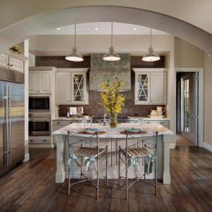 Archway And Custom Designed Cabinets Plus Industrial Pendant Lights Also Island Kitchen With Metal Bar Stools In Transitional Kitchen Plus Tie On Seat Cushions With Engineered Wood Flooring