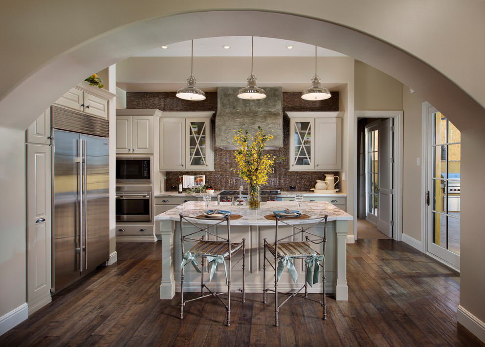 Archway And Custom Designed Cabinets Plus Industrial Pendant Lights Also  Island Kitchen With Metal Bar Stools