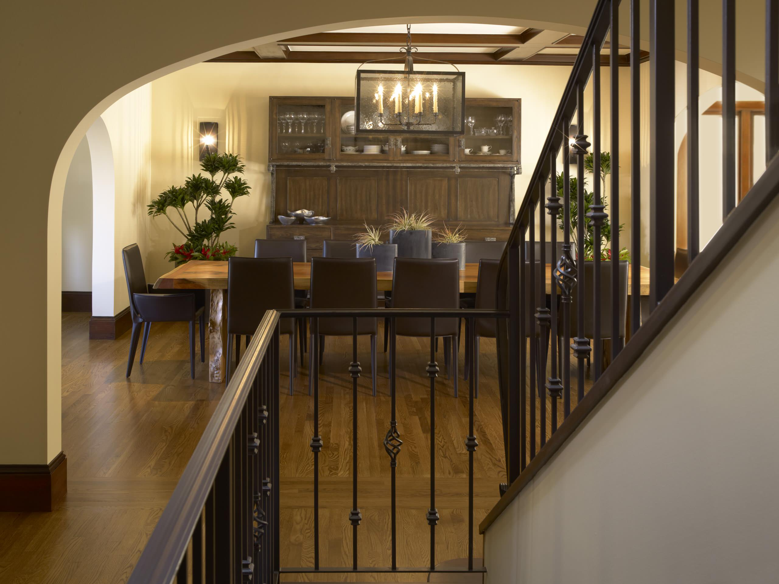 Inspiring Iron Railings Design for Staircase at Your Home: Archway In Traditional Dining Room Plus Chandelier With Coffered Ceiling Also Dining Buffet And House Plants With Leather Dining Chairs And Neutral Colors Also Wall Sconce Plus Iron Railings