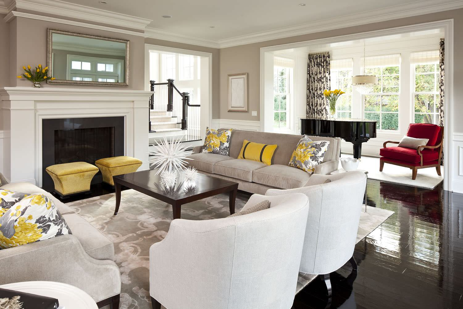 Interesting Home Using Best Interior Paint Ideas: Area Rug On Black Flooring Plus Cocktail Table And Decorative Pillows For Couches Also Fireplace And Mirror In Transitional Living Room With Best Interior Paint Plus Red Chair And Sofa