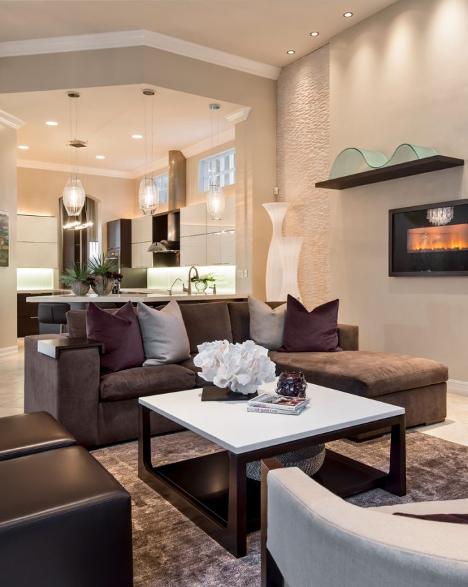 Awesome Floating Shelf And Integrated Fireplace With Decorative Wall Panels Also Open Concept Plus Recessed Lights With Sectional Sofa And Sitting Area Plus Decorative Pillows For Couches Also Upholstered Chair