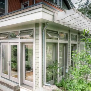 Awning Windows As Transom Windows Also French Doors For Glass Doors With Neutral Colors In Studio And Sunroom Plus Trellis Also Wood Siding With Brick Pavers Plus Small Garden Ideas