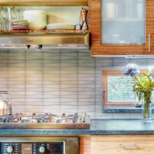 Awning Windows In Contemporary Kitchen Plus Floral Arrangement And Kitchen Hardware Also Kitchen Shelves With Range Hood And Backsplashes Plus Under Cabinet Lighting Also Wood Cabinets