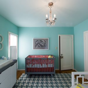 Baby Room With Tiffany Blue Paint And Modern Chandelier Plus Changing Pad Also Changing Table With Houndstooth Area Rug Plus Nursery And Orange Crib Bedding Also Storage Drawers