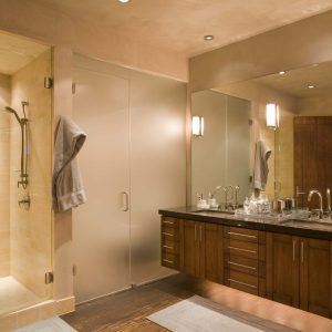 Backlighting And Bathroom Hardware Plus Bathroom Mirror In Contemporary Bathroom With Ceiling Lighting And Dark Flooring Plus Floating Vanity Also Water Closet With Frosted Glass