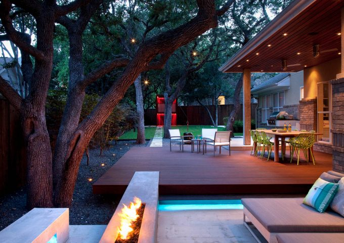 Backyard Landscape Plus Black Gravel And Rectangular Fire Pit With In Ground Lighting Plus Modern Chair And Modern Table Also Outdoor Dining With Stepping Stone Path And Deck Lighting