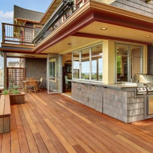 Balcony Deck Plus Railing Also Covered Grill In Outdoor Kitchen And Planter Boxes In Seattle Craftsman With Shingle Siding And Recessed Lighting Also Glass Door Plus Windows