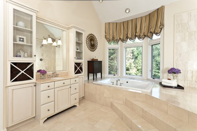 Baltimore Interior Decorators And Bay Window For Traditional Bathroom Plus Dark Stained Wood Dresser And Recessed Lights Also Soaking Tub With Steps And Vaulted Ceiling Also Bathroom Cabinet
