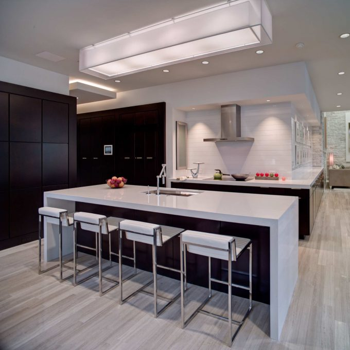 Bar Light And Black Cabinets With Cabinet Space Plus Cooktop Stove Also Kitchen Island Sink In Contemporary Kitchen With Light Wood Flooring And Dal Tile Plus Range Hood Also Recessed Lighting