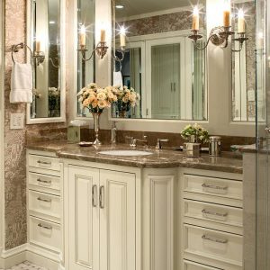 Baseboards And Basketweave Plus Bathroom Hardware Also Bathroom Mirror With Beveled Mirror Plus Sconce And Ceiling Lighting Also Floral Arrangement On Marble Countertop For Wood Cabinets