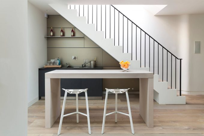 Basement Bar Plus Counter Stools And Island Also Sink In Under Stair Kitchen With Portable Bars And Wall Shelves Also Wall Mount Faucet For Under Stairs Bar Plus Handrail In Contemporary Home Bar