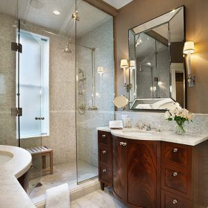 Bathroom Bench And Bathroom Lighting With Beveled Mirror Also Sconce For Traditional Bathroom With Tile Flooring And Floral Arrangement On Freestanding Vanity In Shared Bathroom