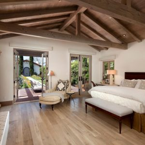 Beams Ceiling For Mediterranean Bedroom Plus Master Bed And Bench Also French Doors In Master Bedroom With Hardwood Floor Colors Plus Sitting Area Also Cordless Table Lamp On Bedside Table