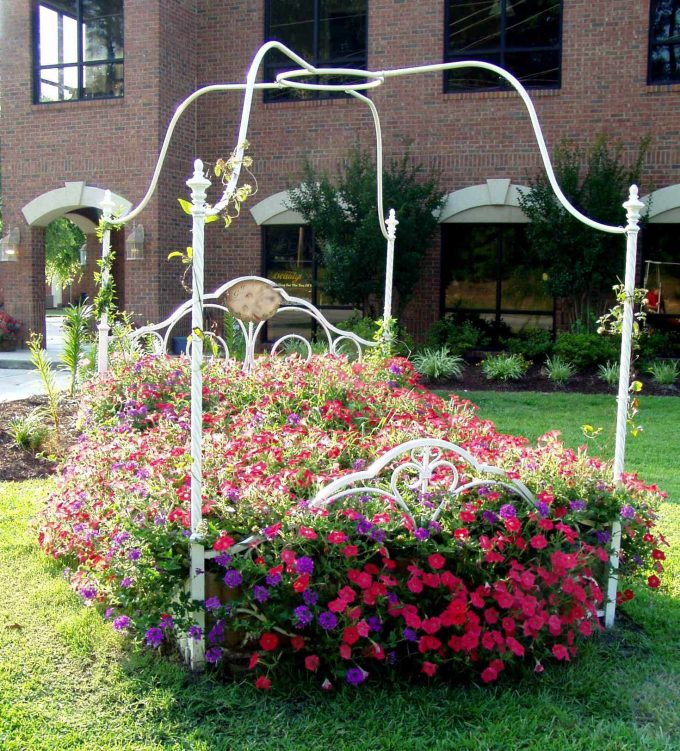Bed Of Flowers In Eclectic Landscape With Iron Frame And Flower Bed For Garden Statue Plus Grass Also Perennial And Planter With Sleeping Porch Also Brick Wall Designs For Exterior Ideas