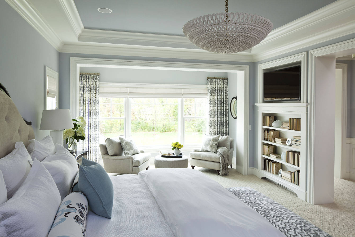 Bedding And Bed Pillows Plus Upholstered Headboard Also Bookcase With Contemporary Chandelier And Crown Molding Plus Best Interior Paint With Painted Ceiling And Textured Carpet