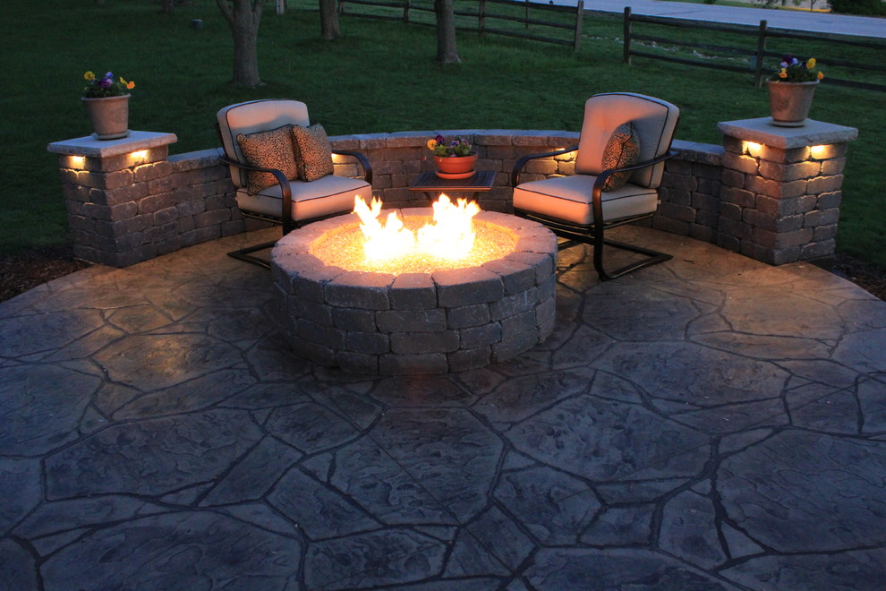 Top Materials for Patio Using Stamped Concrete Patio: Belgard Seat Wall Plus Fire Fit And Stamped Concrete Patio In Contemporary Patio With Low Voltage Lighting And Outdoor Armchairs Plus Outdoor Cushion Also Potted Flowers