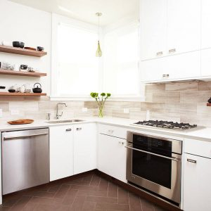 Belmont And Corner Windows With Backsplashes Also Floating Shelves Plus Floral Arrangement With Herringbone Tile Flooring And Neutral Colors Also Pendant Lighting And Stainless Steel Appliances