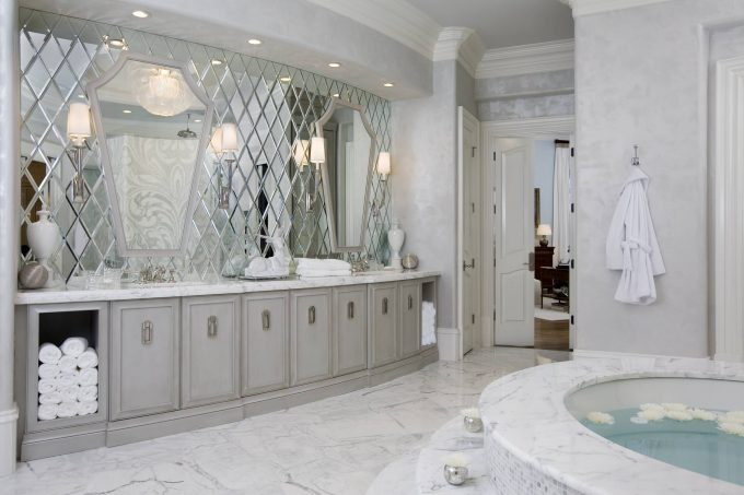 Beveled Mirror In Great Bathroom With Calacatta Marble Also Crown Molding Plus Elegant Design Ideas With Marble Flooring And Round Tub For Spa Plus Vanity With Storage Towel Also Sink