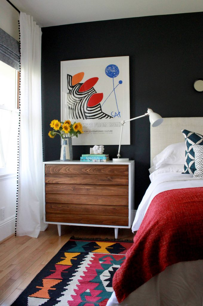 Black Accent Wall In Contemporary Kids With Hardwood Flooring Plus Calder Art Print And Danish Modern Dresser Also Ikat Rug With Linen Headboard And Red Blanket Also White Bedding Plus Reading Lamp