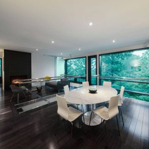 Black And White For Modern Dining Room Plus Black Fireplace And Black Side Chair With Engineered Wood Flooring And Glass Railing Plus Oversized Window Also Recessed Lighting With White Dining Furniture
