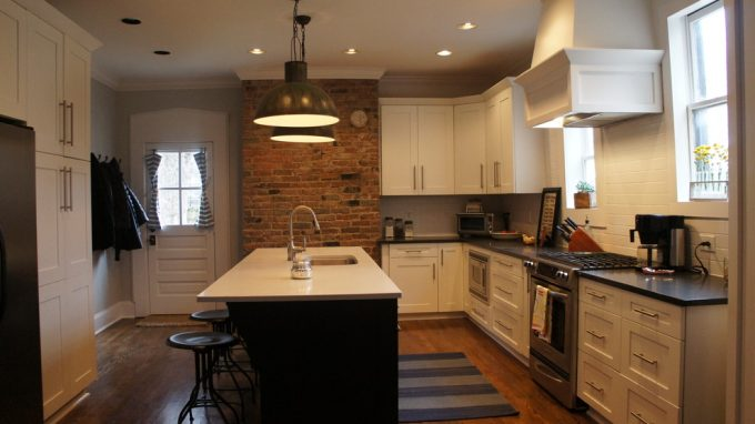 Black And White For Transitional Kitchen With Contrasting Island Plus Exposed Brick Also Shaker Style With Tapered Hood And Under Cabinet Microwave Plus Wood Hood Also Pendant Lighting