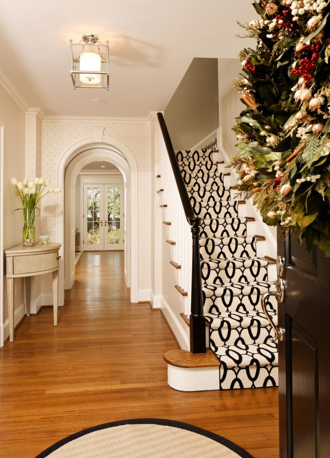 Black And White Stair Runner Plus Stark Carpet Also Ceiling Lighting And Door Wreath With Ivory Patterned Wallpaper Also Light Wood Floor And White French Door Plus White Stair Railing For Staircase