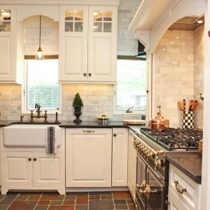 Black Countertop Plus Farmhouse Sink And Conestoga Wood With Subway Tile Backsplash In Traditional Kitchen Plus Refacing Kitchen Cabinets And Inspiring Lighting Also Tile Flooring