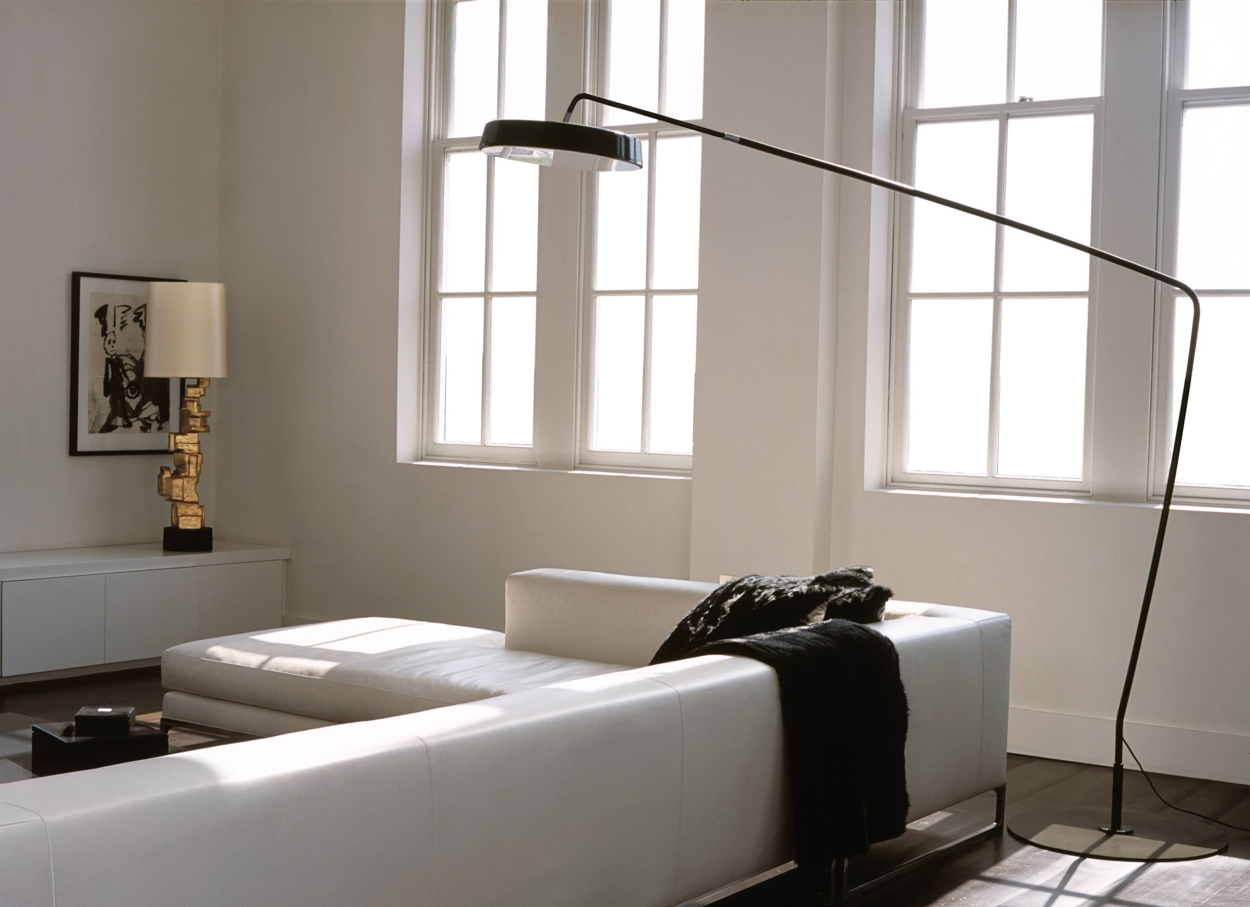 Black Floor Lamp Plus Floor Lamp Also Gold Table Lamp With Leather Sofa In Modern Living Room Plus White Sectional Sofa And Low Coffee Table Plus Wall Decor Also Windows Treatment