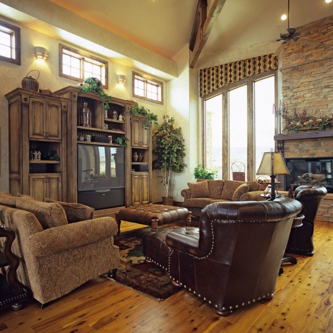 Black Leather Armchairs With Modern Sofa And Wood Floor For Traditional Living Room Design With Custom Entertainment Centers And Wall Sconce Plus Stone Fireplace Also Roman Blinds