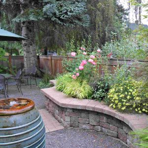 Block And Bubbler For Courtyard With Curved Also Outdoor Dining Plus Fence And Flower Bed With Gravel Also Outdoor Furniture Plus Outdoor Umbrella With Small Garden Ideas And Stone Wall