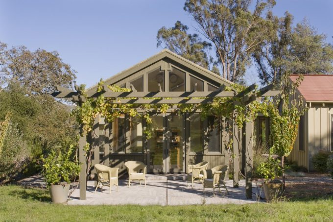 Board And Batten Also Climbing Plants With Concrete Paving And Container Plants Plus Covered Patio With French Doors And Neutral Colors Also Patio Furniture Plus Pergola Ideas In Rustic House
