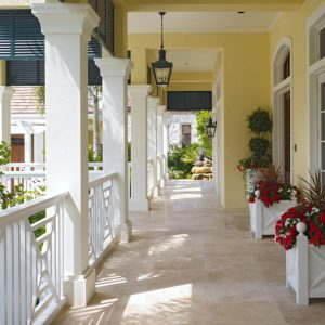 British Colonial With Chippendale Railing For Exterior Ideas Plus Flower Pots And Lantern With Shutters Windows Also Tropical Plus Walkway And Yellow With Planter Boxes For Outdoor Decoration