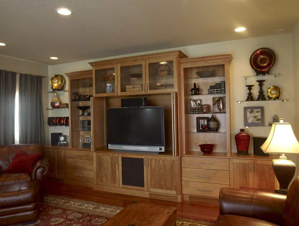 Custom Entertainment Centers for Inspiring Storage Ideas: Brown Leather Sofa With Ottoman Coffee Table And Table Lamp In Traditional Family Room With Custom Entertainment Centers And Contemporary Curtain Plus Wood Flooring Also Feizy Rug
