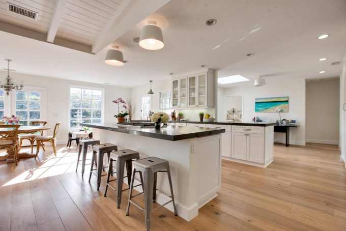 Caesarstone And Grey Countertop With Hardwood Floor Colors Plus Large Window And Metal Barstool For Breakfast With Open Kitchen Plus Skylight Also Tongue And Groove Ceiling