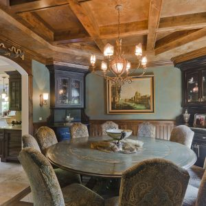 Captivating Layout Chandelier With Coffered Ceiling And Archway Plus Corner China Cabinet With Brown Patterned Dining Chair And Round Dining Table For Elegant Dining Room Plus Wall Sconce