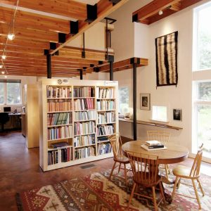 Ceiling Beams With Track Lighting And Bookcase Also Cheap Room Dividers With Pedestal Table And Wood Chairs Plus Area Rug And Cork Floor With Floor To Ceiling Windows