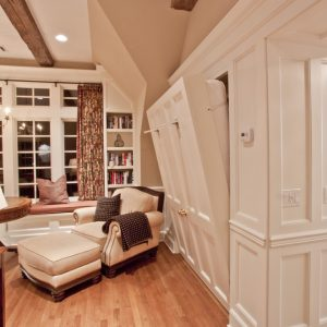 Ceilings And Recessed Lighting With Ceiling Beams Also Murphy Bed With Wall Paneling And Upholstered Armchair Plus Ottoman And Window Seat With Wood Floor