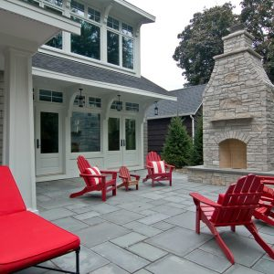 Cement Squares Also Red And White Striped Pillows On Outdoor Wood Chairs Also Outdoor Chaise Lounge Chairs For Contemporary Patio With Stacked Stone Fireplace And Stamped Concrete Patio
