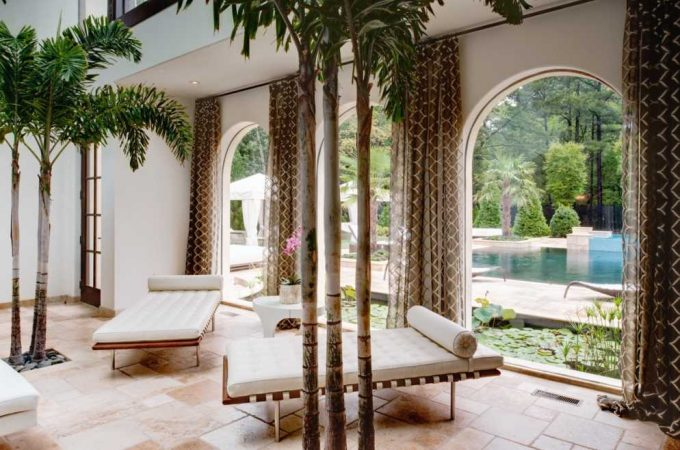 Chaise Longue In Tropical Living Room Plus Drapes And Modern Daybed With High Ceilings Plus House Plants And Indoor Trees For Modern Icons With Neutral Colors And Stone Floor