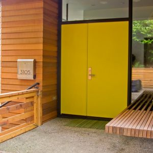 Chartreuse Door And Floating Bench In Contemporary Entry Plus Modern Mailbox And Sidelight Also Transom Window With Concrete Flooring Plus Welcome Mat And Wood Bench Also Wood Gate