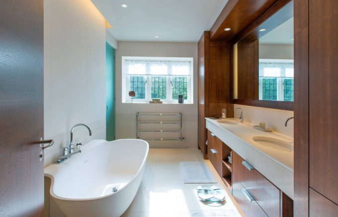 Contemporary Bathroom Plus Bathroom Window With Beige Tiled Floor And Cove Lighting Also Double Sink Vanity With Frameless Mirror Plus Free Standing Bath Tubs And Oval Sinks Also Recessed Lights