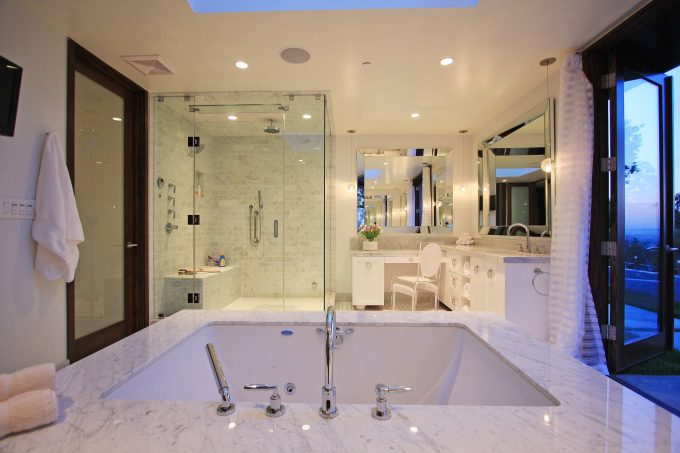 Contemporary Bathroom Plus Vanity With Beveled Mirror And Lucite Chair Also Walk In Shower Ideas With Ceiling Lighting And Neutral Colors Also Shower Bench Plus Soaking Tub In White Bathroom