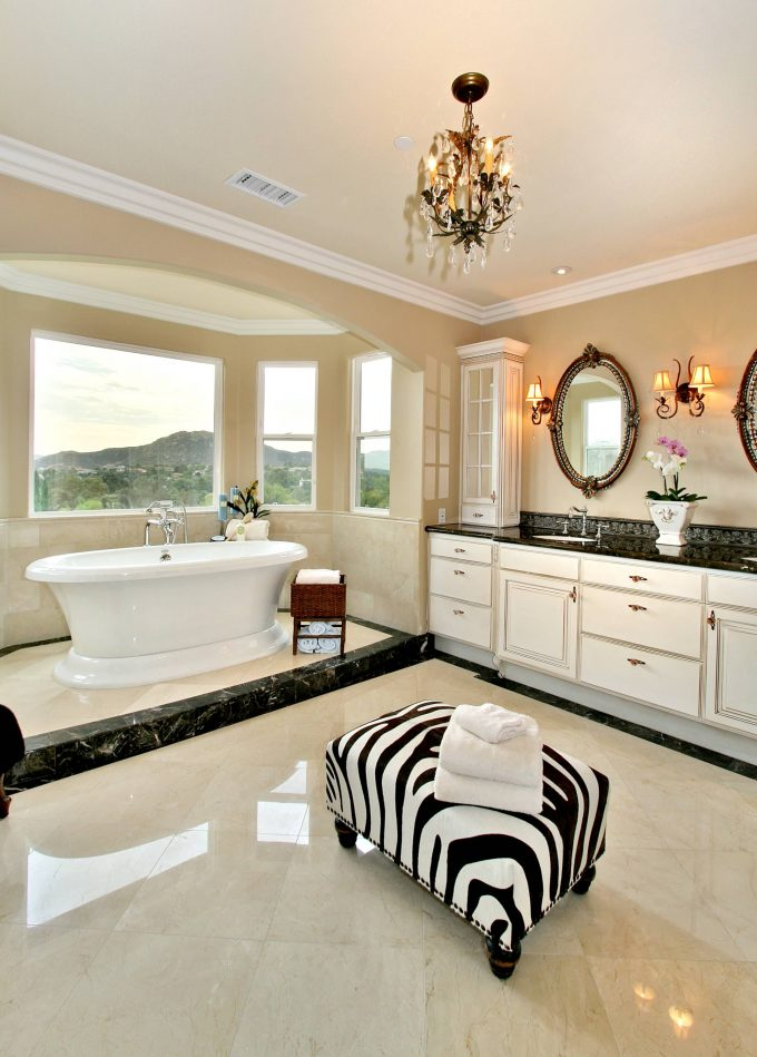 Contemporary Bathroom With Alcove Plus Animal Print Ottoman And Bay Window Also Black Countertops With Crema Marfil Marble Plus Crystal Chandelier And Freestanding Tub
