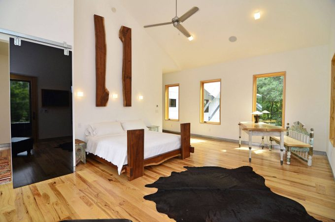 Contemporary Bedroom Plus Artwork With Barn Door Plus Bedroom Desk Also Ceiling Fan And Ceiling Lighting With Cowhide Rug Also Reclaimed Wood Bed And Raw Edge Wood Plus Wall Sconce
