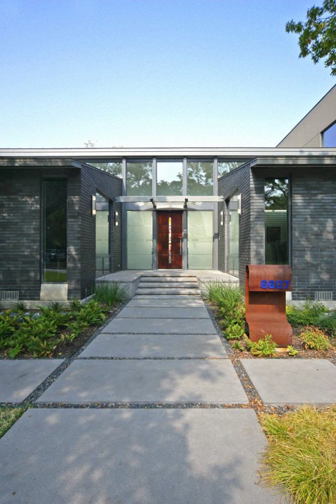 Contemporary Entry With Concrete Walkway Plus Art Glass And Flat Roof Also Front Door With Modern Mailboxes And House Numbers Also Sidelights In Minimalist Home With Exterior Design
