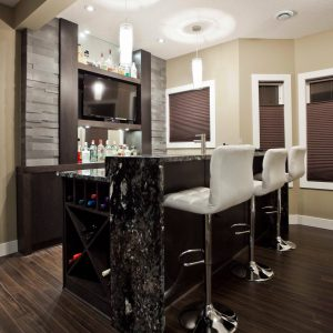 Contemporary Home Bar In Basement Plus Portable Bars And Cabinets With Dark Wood Flooring Also Granite Plus Laminate Flooring And Led Tv With Pendant Lighting Also Waterfall Countertop Plus Wine Storage