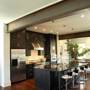 Contemporary Kitchen With Bar Stools And Red Oak Flooring Plus Cabinetry Also Granite Countertop With Undermount Sink On Kitchen Island For Breakfast Bar Plus Pendant Lighting